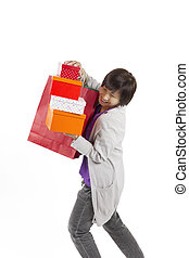 Lady holding bags and gift box with happy action, full length portrait isolated on white background.