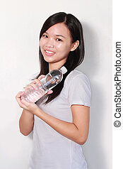 Lady holding bottle of water