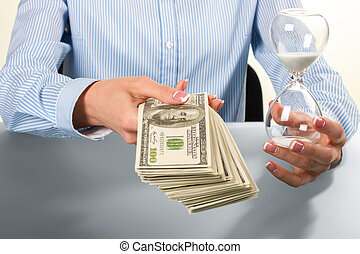 Lady holds hourglass and money.