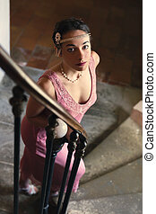 Lady in 1920s dress on staircase
