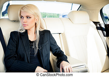 Lady in a luxury car