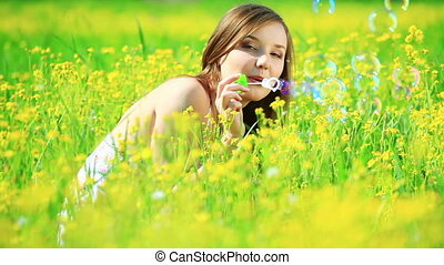 Lady in a yellow field with bubbles