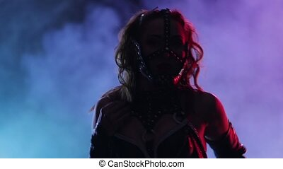 Lady in black leather mask and clothes performs private...