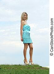 Lady in blue dress in the garden