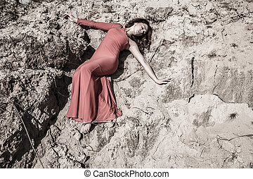 Lady in dress laying in the dirt