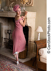 Lady in flapper dress at fireplace