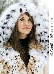 Lady in fur - Beautiful brunette lady in fur coat in the...