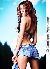 lady in jeans - Shot of a sexy woman posing outdoor.