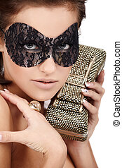 Lady in mask - Young brunette lady with luxury accessories...