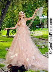lady in peach dress
