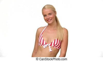 Lady in red and white striped swimsuit looking at the camera