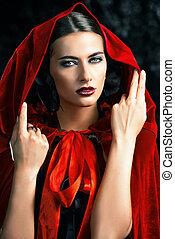 lady in red cloak - Beautiful brunette woman in black...