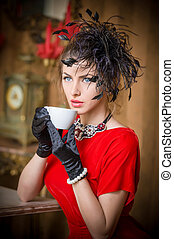 Lady in red drinking coffee
