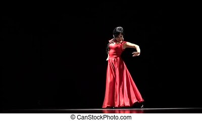 Lady in red. Flamenco Dance. Black background. Slow motion -...