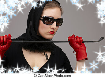 portrait of lady in black headscarf and red gloves with crop