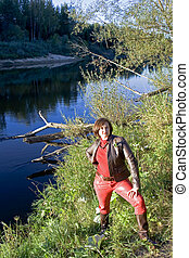 Lady in red on the Gauja riverside in Cesis, Latvia