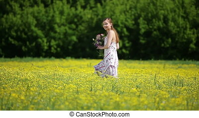 Lady in the meadow with flower