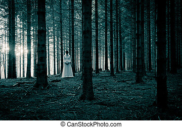 Lady in white dress in the wood