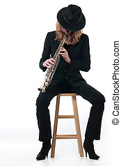 Lady Jazz musician playing the soprano saxophone