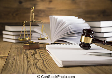 Gold gavel, notebook on wooden table