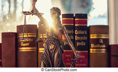 Lady Justice (Justitia) with law books  in a lawyer office