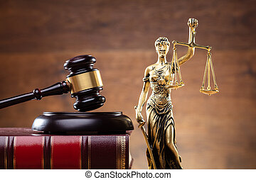 Lady Justice Near Gavel Over Law Book