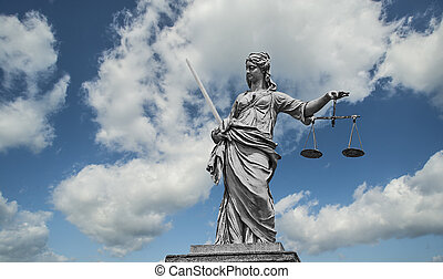 Lady Justice - Statue of Lady Justice holding scales and...