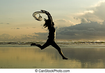 Lady leaps at sunset.