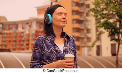lady listening to the audio book - woman enjoys morning in...