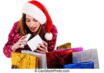 lady opening christmas gift box