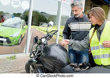 Lady preparing for motorcycle lesson