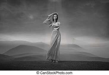 Lady Puppet, young girl standing on a hill