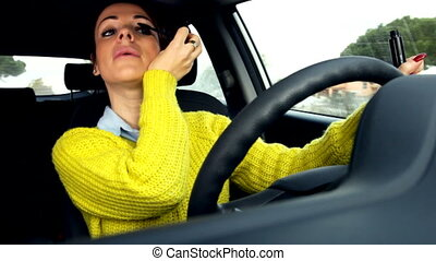 lady putting makeup while driving - Serious girl driving...