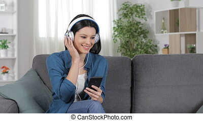 Lady searching and listening to music on phone - Lady...