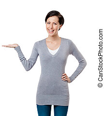 Lady shows pointing hand gesture - Pretty lady shows ...