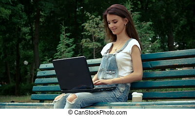 lady sitting in the Park during the summer and prints on a...