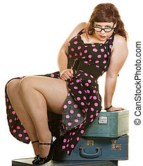 Lady Sitting on Suitcases - Sexy plus size woman sitting on...