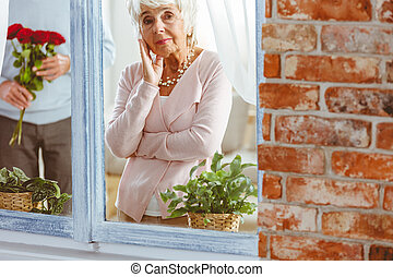 Lady standing in the window