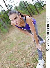 Lady stretching while exercising