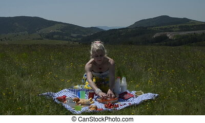 Lady Tearing apart Croissant - Lady on picnic is tearing...