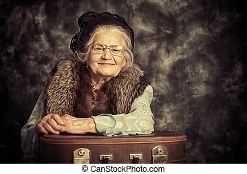 lady traveller - Portrait of a beautiful old lady in an...