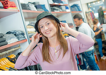 Lady trying on hat