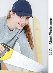 Lady using handsaw