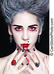 Lady vampire - Portrait of young beautiful stylish gothic...