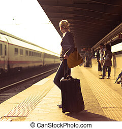 Lady waiting at the railway station.