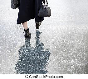 Lady walking in rain