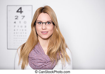 Lady wearing glasses - Image of lady with myopia wearing...