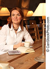 Lady with acne scars holding cup of coffee