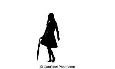 Lady with an umbrella in her hands is dancing. White background. Silhouette