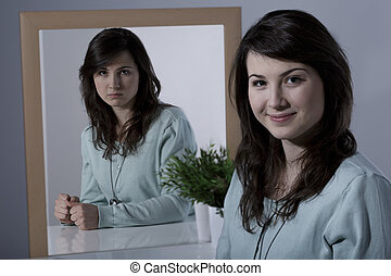 Lady with bipolar disorder sitting at the desk
